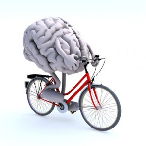 human brain with arms and legs riding a bicycle